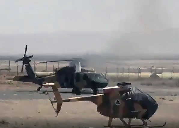 MD-530F without main rotor blades at Gazni military base, june 2021. Burning UH-60A
